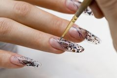 Manicure one's nails. Effective manicure with artificial nails Royalty Free Stock Image
