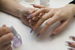 Manicure one's nails. Effective manicure with artificial nails Royalty Free Stock Images