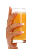 Manicure and orange juice Stock Photos
