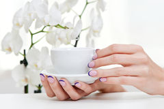 Manicure, orchid and coffee Royalty Free Stock Photo