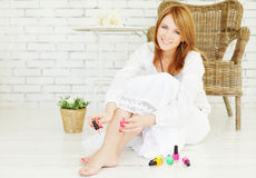 Manicure and pedicure - beautiful woman royalty free stock images