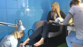 Manicure and Pedicure. Business woman does the combo procedure in the salon: Manicure and Pedicure stock video