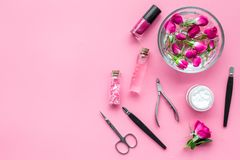Manicure and pedicure equipment for nail bar set on rose background top view mockup. Manicure and pedicure equipment for nail bar set on rose table background royalty free stock photography
