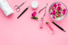 Manicure and pedicure equipment for nail bar set on rose background top view mockup. Manicure and pedicure equipment for nail bar set on rose table background stock photo