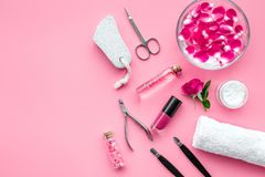 Manicure and pedicure equipment for nail bar set on rose background top view mockup. Manicure and pedicure equipment for nail bar set on rose table background royalty free stock images