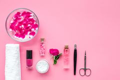 Manicure and pedicure equipment for nail bar set on rose background top view mockup. Manicure and pedicure equipment for nail bar set on rose table background stock photography