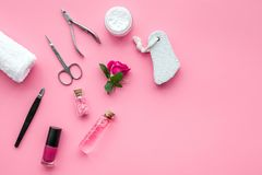 Manicure and pedicure equipment for nail bar set on rose background top view mockup. Manicure and pedicure equipment for nail bar set on rose table background stock images