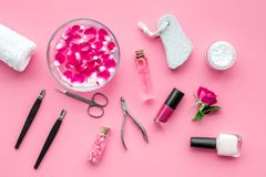 Manicure and pedicure equipment for nail bar set on rose background top view. Manicure and pedicure equipment for nail bar set on rose table background top view stock image