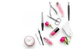 Manicure and pedicure equipment for nail bar set on white background top view mockup. Manicure and pedicure equipment for nail bar set on white table background royalty free stock images