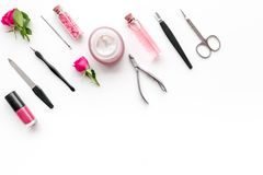 Manicure and pedicure equipment for nail bar set on white background top view mockup. Manicure and pedicure equipment for nail bar set on white table background royalty free stock photos