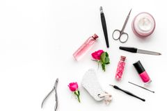 Manicure and pedicure equipment for nail bar set on white background top view mockup. Manicure and pedicure equipment for nail bar set on white table background stock photo