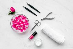 Manicure and pedicure equipment for nail bar set on white stone background top view. Manicure and pedicure equipment for nail bar set on white stone table stock photos
