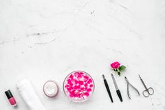 Manicure and pedicure equipment for nail bar set on white stone background top view mockup. Manicure and pedicure equipment for nail bar set on white stone table royalty free stock image