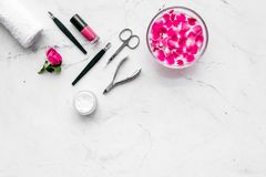 Manicure and pedicure equipment for nail bar set on white stone background top view mockup. Manicure and pedicure equipment for nail bar set on white stone table stock images