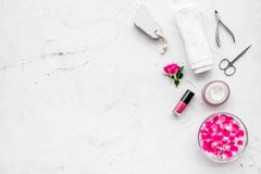 Manicure and pedicure equipment for nail bar set on white stone background top view mockup. Manicure and pedicure equipment for nail bar set on white stone table royalty free stock photography