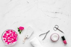 Manicure and pedicure equipment for nail bar set on white stone background top view mockup. Manicure and pedicure equipment for nail bar set on white stone table stock image