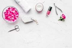 Manicure and pedicure equipment for nail bar set on white stone background top view mockup. Manicure and pedicure equipment for nail bar set on white stone table stock photos