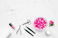Manicure and pedicure equipment for nail bar set on white stone background top view mockup. Manicure and pedicure equipment for nail bar set on white stone table royalty free stock images