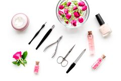 Manicure and pedicure equipment for nail bar set on white background top view. Manicure and pedicure equipment for nail bar set on white table background top royalty free stock images