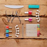 Manicure and pedicure tools. On wooden background. Flat lay Royalty Free Stock Photo