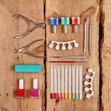 Manicure and pedicure tools. On wooden background. Flat lay stock photography