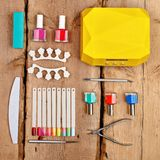 Manicure and pedicure tools. On wooden background. Flat lay royalty free stock photos
