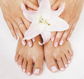Manicure pedicure woman legs with flower lily Stock Photo