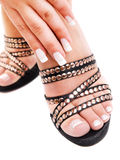 Manicure and pedicure. Young woman's hand and foot with manicure and pedicure royalty free stock image