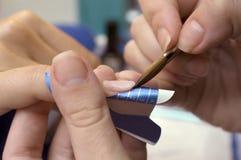 Manicure precedure. Manicure procedure in beauty center Stock Photo