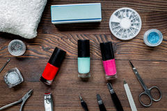Manicure preparation set with nail polish bottles on wooden background top view. Manicure preparation set with nail polish bottles on wooden table background top Stock Images