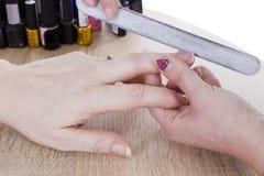 Manicure procedure in beauty salon Stock Photography