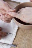Manicure procedure in beauty salon Stock Image