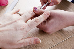 Manicure procedure in beauty salon Stock Photos