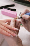 Manicure procedure by nailing. In salon Royalty Free Stock Image