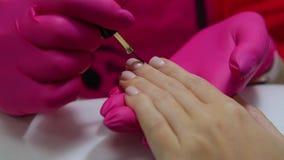Procedure of manicure at beauty salon stock video