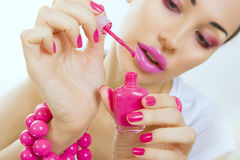 Manicure process - beautiful girl makes pink manicure Royalty Free Stock Photography