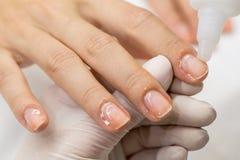 Manicure process in a beauty salon Stock Photos