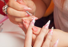 Manicure process in beauty salon showing coloring Stock Photos