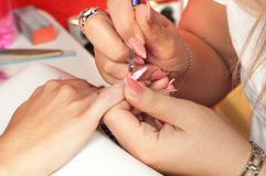 Manicure process in beauty salon Royalty Free Stock Image