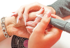 Manicure process in beauty salon showing polishing Stock Images
