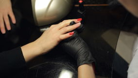 Manicure, process of coating nail with red varnish stock video