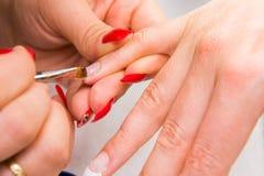 Manicure process Stock Photos