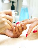 Manicure process... Female hands Royalty Free Stock Photography