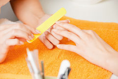 Manicure process on female hands Stock Photos