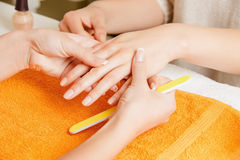 Manicure process on female hands Royalty Free Stock Photography