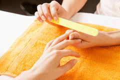 Manicure process on female hands Royalty Free Stock Image