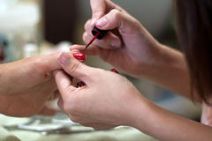 Manicure with red fingernail polish Royalty Free Stock Image
