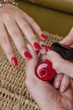 Manicure with a red polish nails Royalty Free Stock Photo