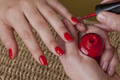 Manicure with a red polish nails Stock Photos
