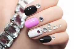 Manicure with rhinestones. Colorful manicure oval shape nails with rhinestones stock photos